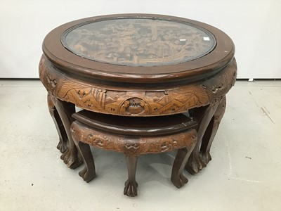 Lot 8 - Chinese circular carved coffee table with integral nest of tables