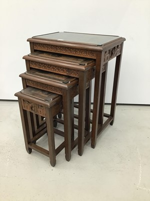Lot 7 - Chinese carved wooden nest of three coffee tables