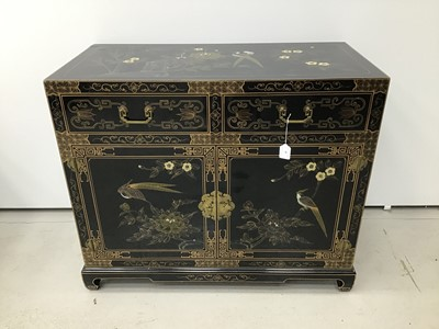 Lot 4 - Chinese black lacquered cupboard with chinoiserie gilded decoration, two drawers and cupboards below