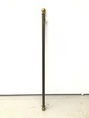 Lot 31 - Antique curtain pole with brass terminals, 128cm long