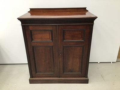 Lot 66 - Good quality Edwardian mahogany cupboard with dentil cornice, shelved interior enclosed by two panelled doors, 92cm wide x 107cm high x 47cm deep.