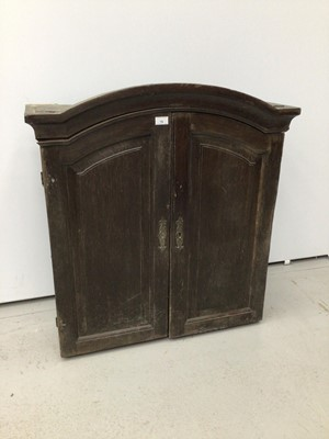 Lot 78 - 18th century French chestnut cabinet, arched form, e closed by pair of panelled doors, 81cm wide x 24cm deep x 106cm high