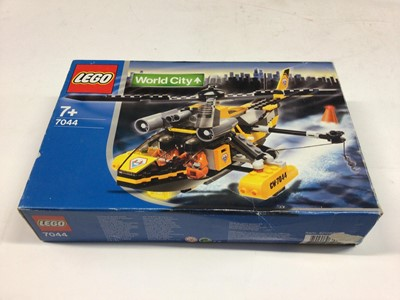 Lot 9 - Lego 7286 Police Bundle, 3180 Tank Truck, 7991 Carbarge Truck, 7044 Coastguard Helicopter, 60042 City Bundle, all including minifigs and instructions, Boxed