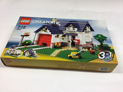 Lot 16 - Lego Creator 7346 Seaside House 3 in 1, 5861 Apple Tree House 3 in 1, 5766 House 3 in 1, 31050 Shop Corner Deli, all with instructions, Boxed