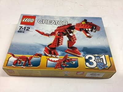 Lot 17 - Lego Creator 6914 Dinosaur 3 in 1, 5764 Robot 3 in 1, 31018 Motorbike 3 in 1, 40107 Christmas Special with minifigs, all with instructions, Boxed