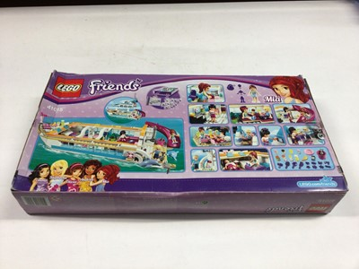 Lot 61 - Lego 41015 Friends (Boat), 41094 Friends (Lighthouse), 41008 Friends (Heartlake City Pool), all with instructions (41094 one book only), Boxed