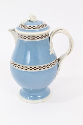 Lot 22 - Pearlware Mocha Ware milk jug and cover, c.1800