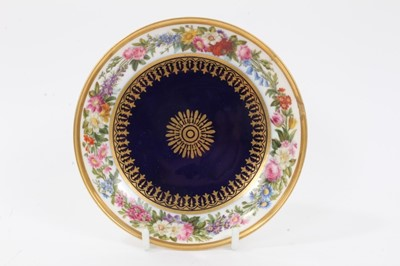 Lot 44 - Sevres dish, finely painted with flowers around the edge, the centre with gilt patterns on a bleu lapis ground, printed and inscribed marks to base, 15.25cm diameter