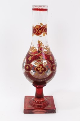 Lot 47 - Bohemian glass hookah base, decorated with gilt foliate patterns on a red ground, 29.5cm height