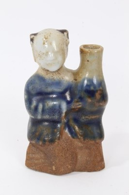 Lot 48 - Chinese Qing biscuit porcelain water dropper, in the form of a boy holding a vase, the bottom unglazed and the top glazed in two tones of blue, 7.5cm height