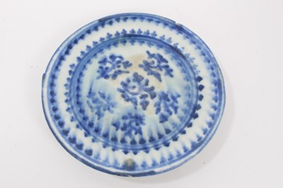 Lot 50 - Persian Qajar tin glazed pottery dish, painted in blue with a foliate pattern, 17cm diameter
