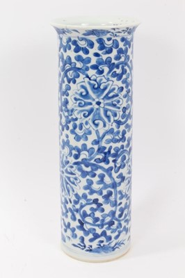 Lot 51 - Chinese blue and white porcelain sleeve vase, c.1900, painted with a scrolling foliate pattern, four-character mark to base, 31cm height
