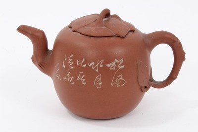 Lot 64 - Chinese Yixing teapot, leaf and branch form handle, spout and lid, the body decorated with calligraphy on one side and a foliate motif on the other, seal mark inside the lid, 15.5cm length x 10cm h...