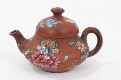 Lot 65 - Miniature Chinese Yixing teapot, enamelled with flowers, 5cm height x 7.5cm length