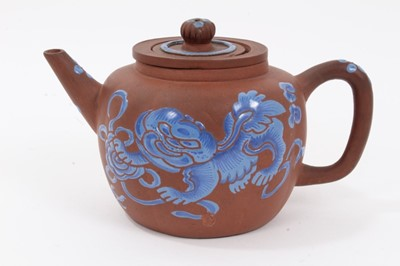 Lot 67 - Chinese Yixing teapot and strainer, enamelled in blue with a foo dog, and auspicious symbols verso, seal mark to base, 12cm height x 20cm length