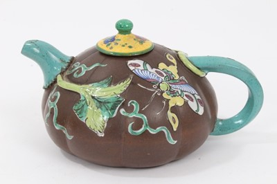 Lot 68 - Chinese Yixing teapot, of pumpkin form, decorated in relief and in enamels with foliate patterns and an insect, 10cm height x 18cm length