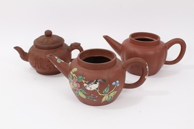 Lot 69 - Three Chinese Yixing teapots, including one enamelled with birds and flowers, another of plain melon form, and another with calligraphy, all with seal marks, between 19cm and 23cm length