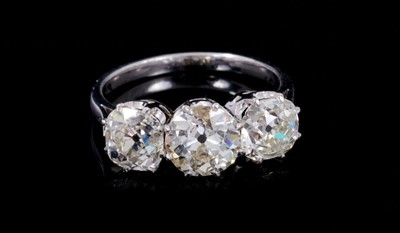 Lot 267 - Impressive diamond three stone ring with three old cut cushion-shape diamonds estimated to weigh approximately 4.05ct in total, in claw setting on 18ct white gold shank. Ring size N