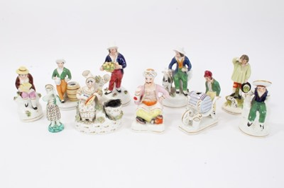 Lot 77 - Collection of ten Staffordshire figures, including a Turk, a man pushing a wheelbarrow, etc, between 9cm and 14cm height