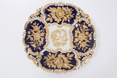 Lot 78 - Meissen gilt-highlighted cobalt blue dish, decorated with flowers in relief, crossed swords mark to base, 30cm diameter