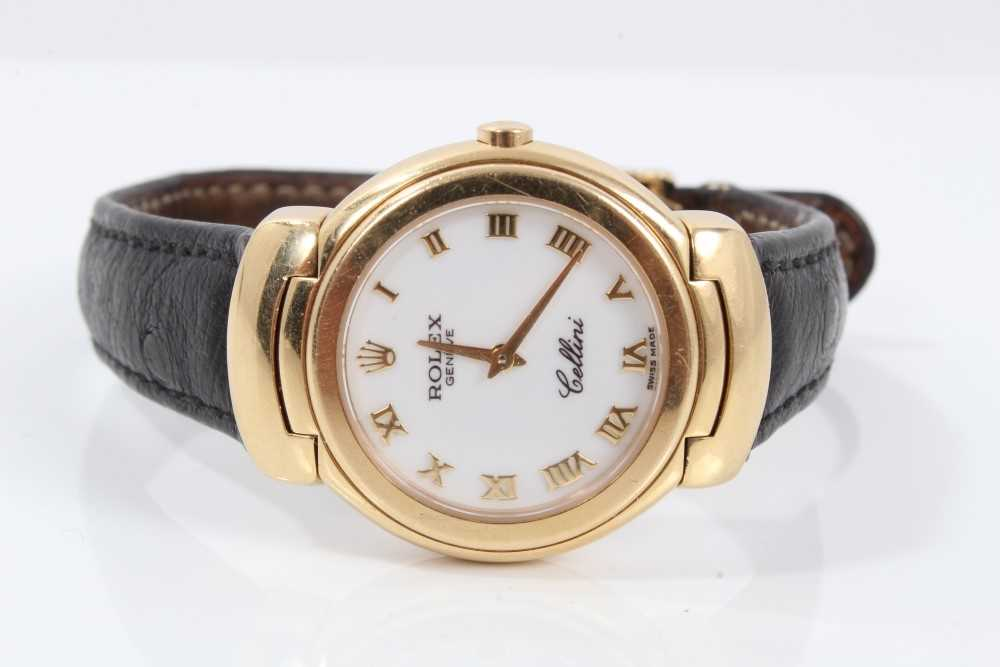 359 - Ladies Rolex Cellini 18ct gold wristwatch with circular white enamel dial with applied gold Roman numerals and gold hands in circular 18ct gold case with articulated gold lugs on Rolex black leathe...