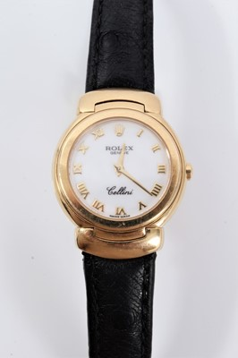 Lot 359 - Ladies Rolex Cellini 18ct gold wristwatch with circular white enamel dial with applied gold Roman numerals and gold hands in circular 18ct gold case with articulated gold lugs on Rolex black leathe...