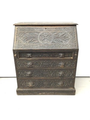 Lot 46 - 19th century carved oak bureau