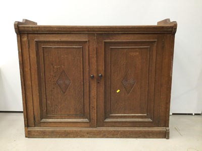 Lot 57 - Late Victorian oak cupboard with two panelled doors