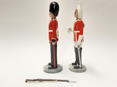 Lot 23 - Two Royal Doulton figures - The Guardsman HN2784 and The Lifeguard HN2781
