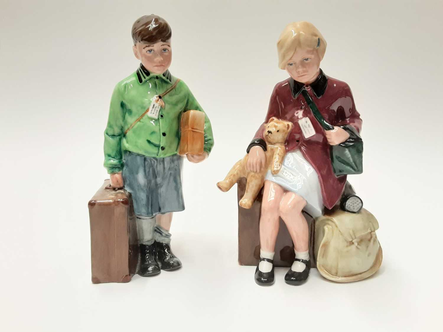 Lot 24 - Two Royal Doulton limited edition figures - The Boy Evacuee HN3202, number 3098 of 9500 and The Girl Evacuee HN3203, number 3590 of 9500