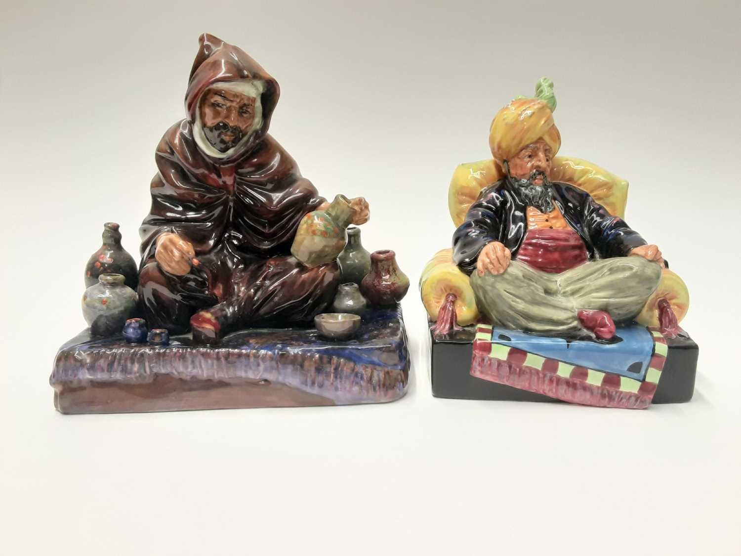 Lot 25 - Two Royal Doulton figures - Abdullah HN2104 and The Potter HN1493