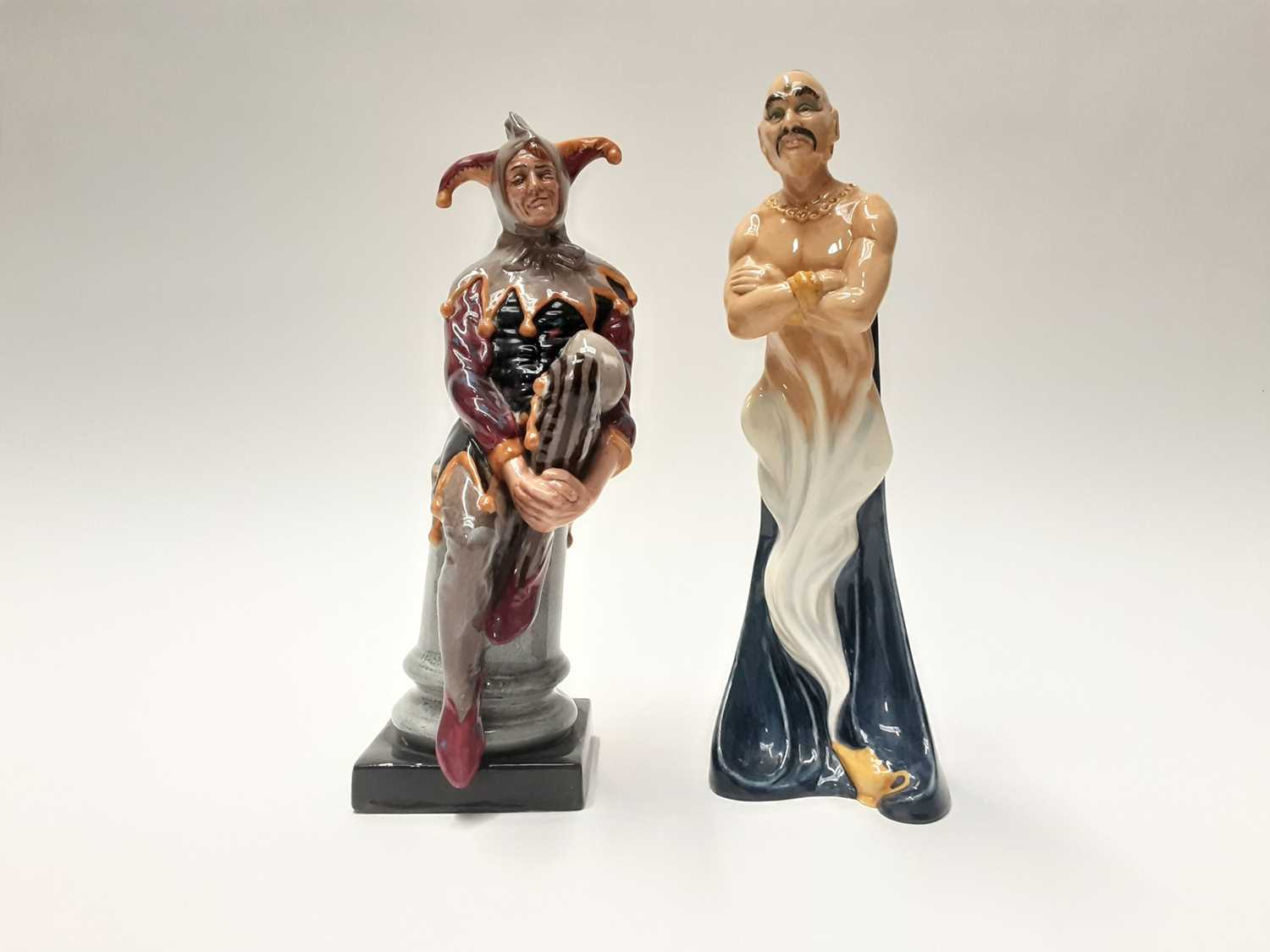 Lot 27 - Two Royal Doulton figures - The Genie HN2989 and The Jester HN2016