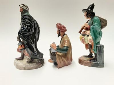 Lot 30 - Three Royal Doulton figures - The Mask Seller HN2103, Omar Khayyam HN2247 and Good King Wenceslas HN2118