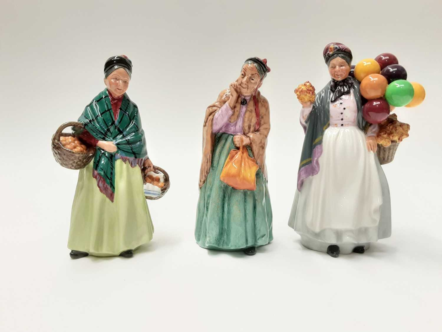 Lot 37 - Three Royal Doulton figures - Biddy Pennyfarthing HN1843, The Orange Lady HN1953 and Bridget HN2070
