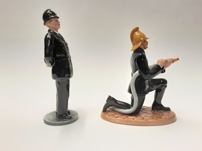 Lot 41 - Two Royal Doulton figures - The Bobby HN2778 and Fireman HN4411