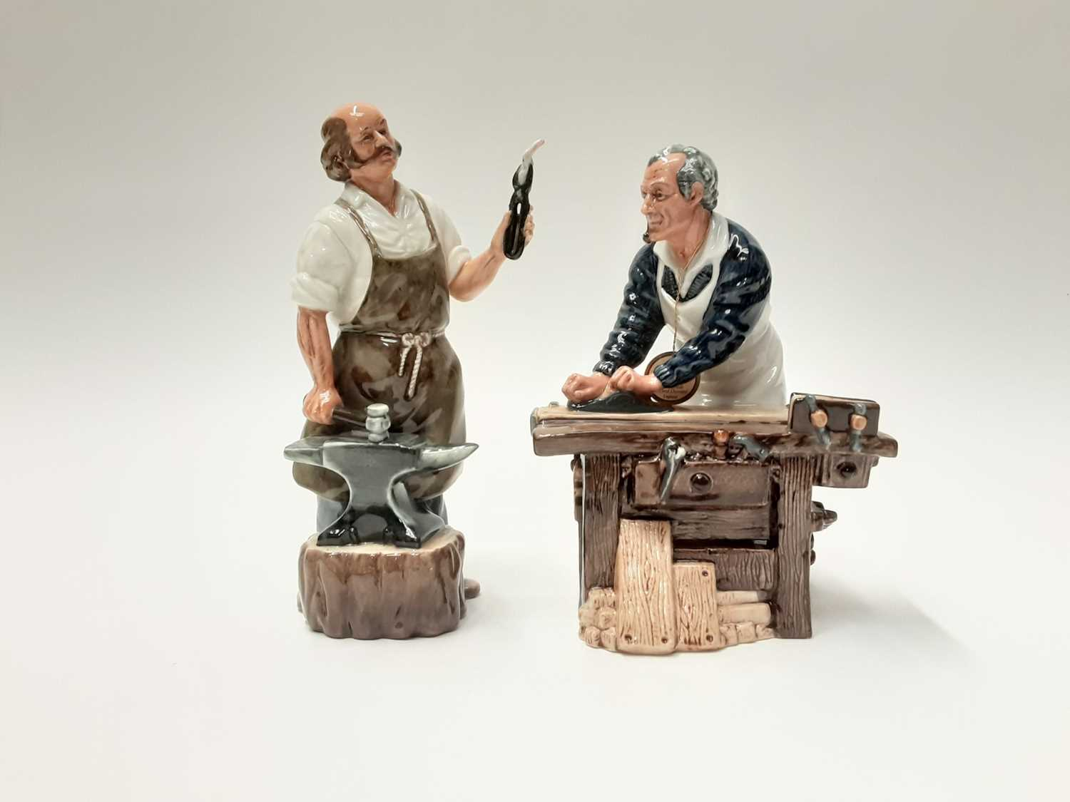 Lot 43 - Two Royal Doulton figures - The Carpenter HN2678 and The Blacksmith HN2782