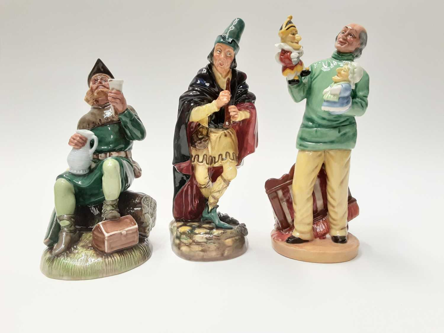 Lot 47 - Three Royal Doulton figures - The Pied Piper HN2102, Robin Hood HN2773 and Punch and Judy Man HN2765