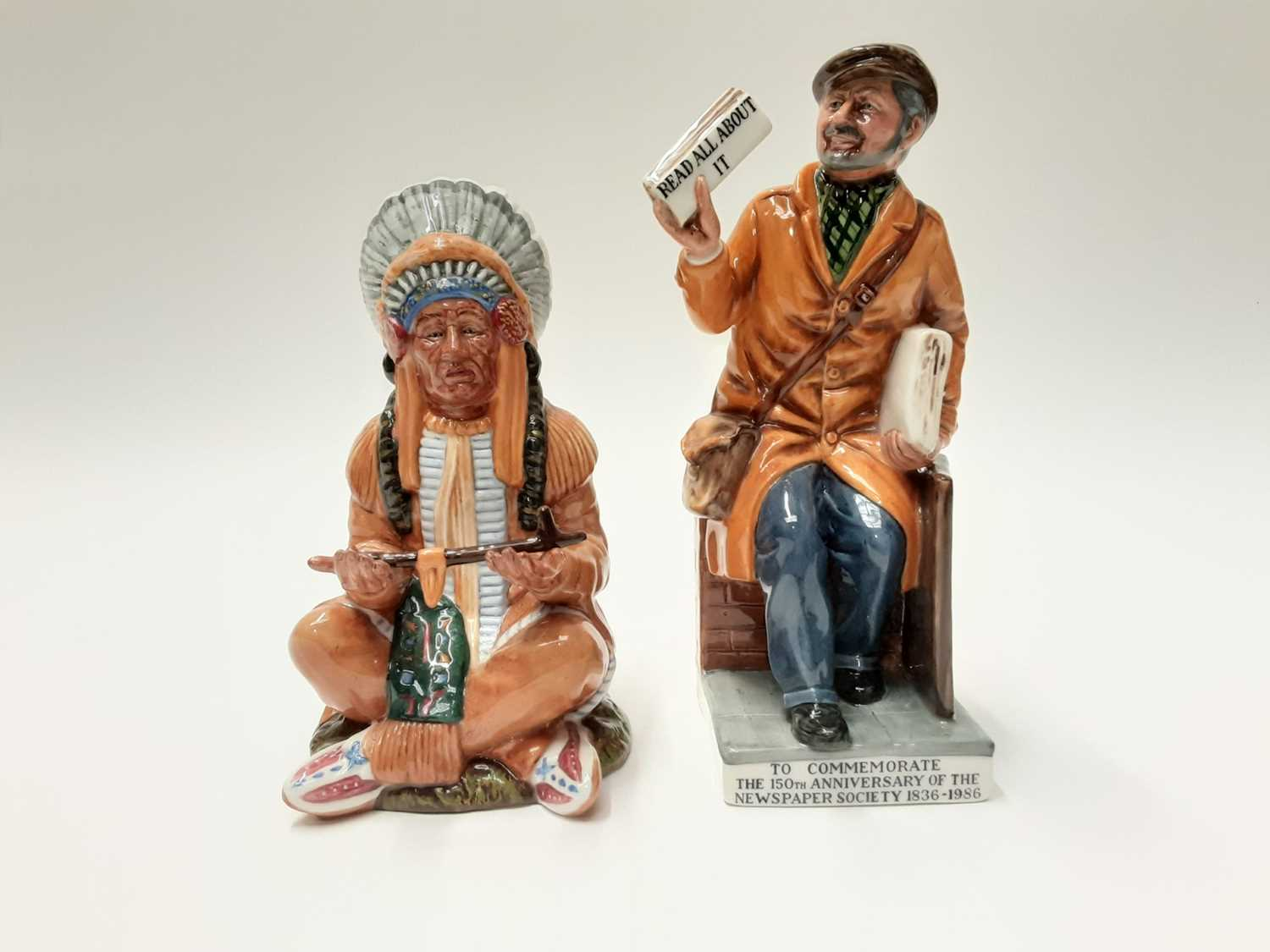 Lot 52 - Royal Doulton limited edition figure - The Newsvendor HN2891, number 586 of 2500, plus another Royal Doulton figure - The Chief HN2892 (2)