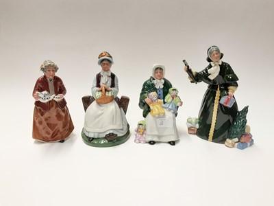 Lot 68 - Four Royal Doulton figures - Christmas Parcels HN2851, Rest Awhile HN2728, Teatime HN2255 and The Rag Doll Seller HN2944
