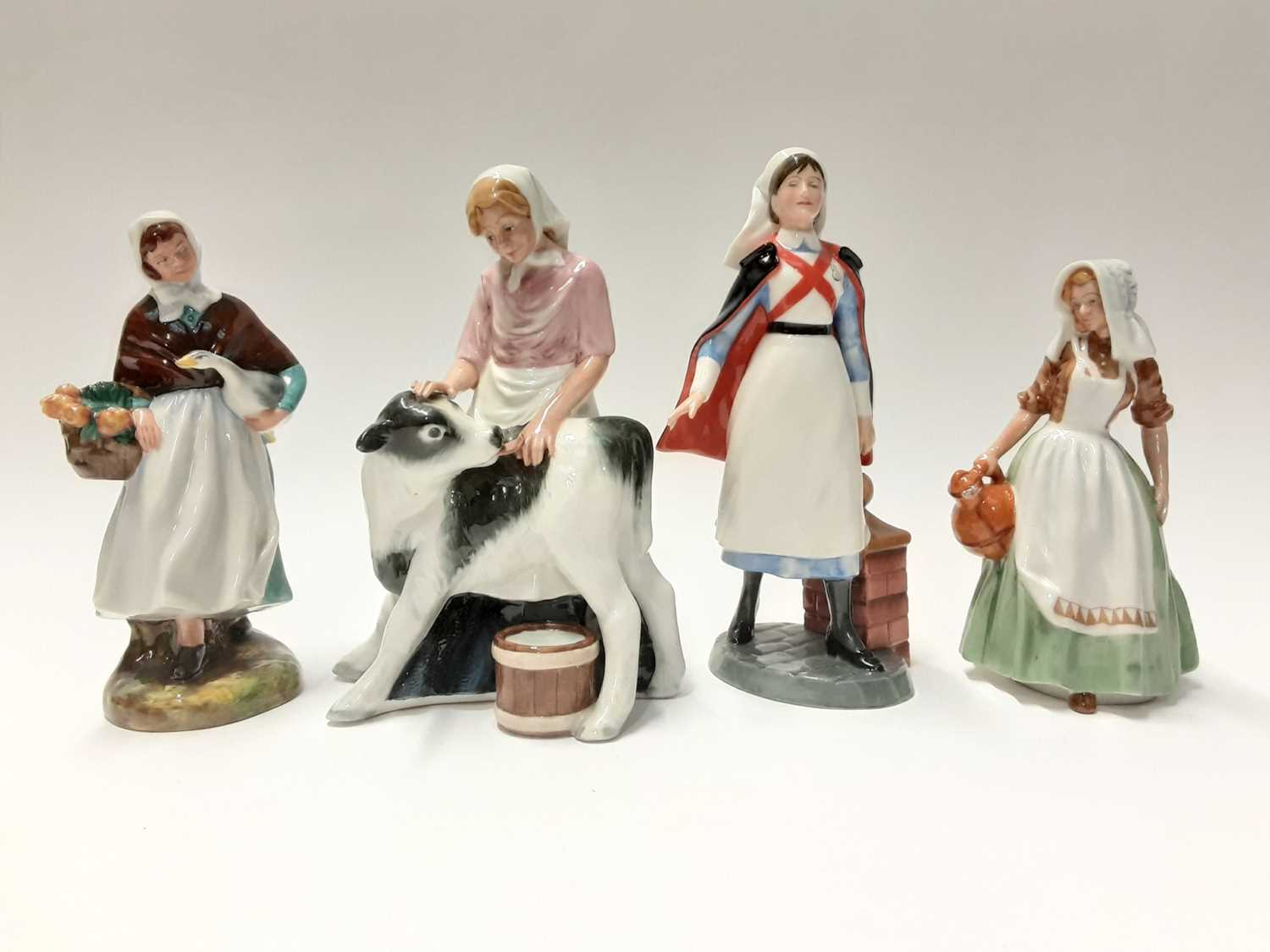 Lot 72 - Four Royal Doulton figures - Country Maid HN3163, Nurse HN4287, The Milkmaid HN2057 and Country Lass HN1991