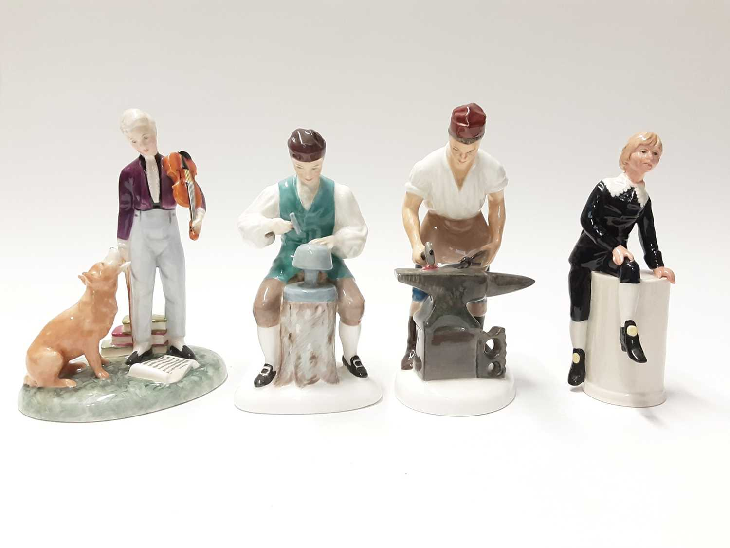 Lot 76 - Four Royal Doulton figures - The Young Master HN2872, The Silversmith of Williamsburg, HN2208, Little Lord Fauntleroy HN2972 and The Blacksmith of Williamsburg HN2240