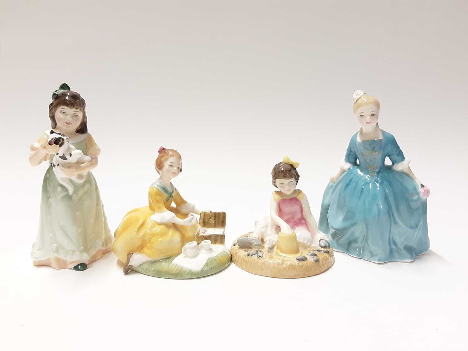 Lot 86 - Eight Royal Doulton figures - On The Beach HN3877, Picnic HN2308, My First Figurine HN3424, Almost Grown HN3425, Home At Last HN3697, Dinnertime HN3726, Special Friend HN3607 and A Child from Willi...