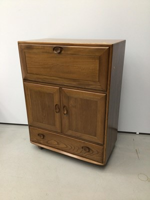 Lot 37 - Ercol golden dawn elm drinks cabinet