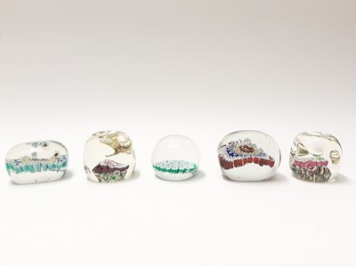 Lot 165 - Five various Murano Art Glass Paperweights including two 1960's oblong and two dimpled (6)