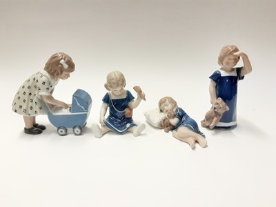 Lot 150 - Four Royal Copenhagen porcelain figures including girl with pram and girl with Teddy bear, model numbers 675, 673, 676 and 407