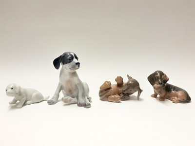 Lot 155 - Four Royal Copenhagen porcelain dogs, model numbers 206, 1408, 3140 and 1311