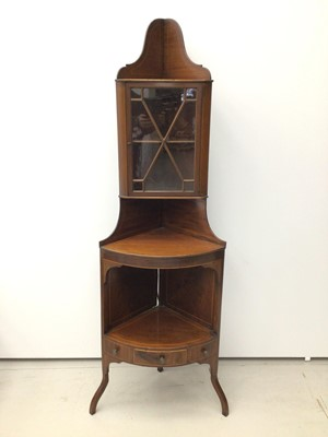 Lot 9 - 19th century inlaid mahogany corner cupboard, standing on bowfronted base, adapted from a corner washstand