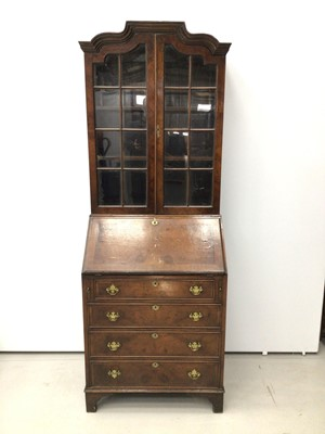 Lot 13 - Georgian style walnut crossbanded bureau bookcase