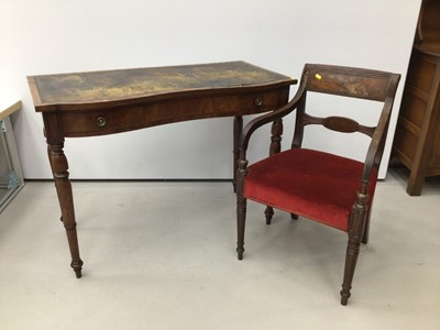 Lot 20 - Victorian figured mahogany serpentine front writing table, together with a Regency mahogany carver chair