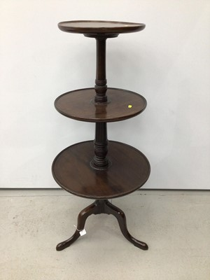 Lot 40 - George III mahogany three tier dumb waiter, three dished circular tiers on tripod base, 110cm high